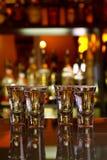 Quatro tiros do tequila com cal e sal Imagens de Stock
