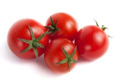 Quatro tomates de cereja vermelhos Imagem de Stock Royalty Free