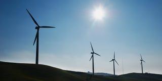 Quatro turbinas de vento Fotografia de Stock Royalty Free