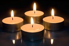 Quatro velas imagem de stock