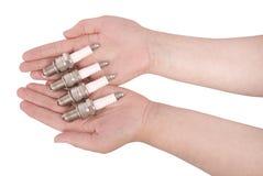 Quatro velas de ignição no trajeto de grampeamento aberto das palmas Fotografia de Stock