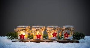 Quatro velas do advento na neve Imagem de Stock Royalty Free
