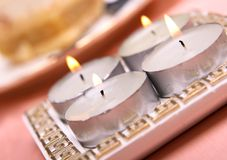 Quatro velas em uma tabela Imagem de Stock Royalty Free