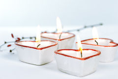 Quatro velas heart-shaped fotografia de stock royalty free
