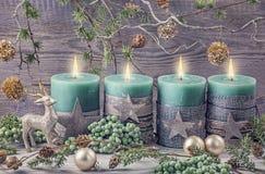 Quatro velas verdes do Natal Fotografia de Stock