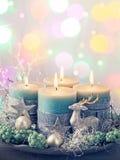 Quatro velas verdes do Natal imagens de stock