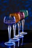 Quatro vidros da cor em um contador da barra Foto de Stock Royalty Free