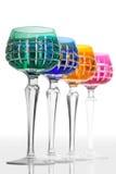 Quatro vidros da cor em um contador da barra Imagens de Stock