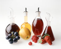Quattro aceti della frutta Fotografie Stock Libere da Diritti