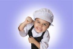Quattro anni di ragazza del cuoco unico Immagini Stock