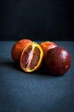 Quattro arance rosse Fotografia Stock Libera da Diritti