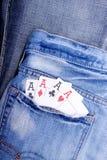 Quattro assi in casella delle blue jeans Immagine Stock