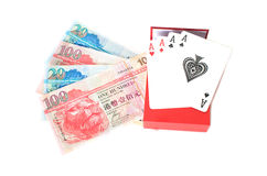Quattro assi e banconote di Hong Kong Fotografie Stock