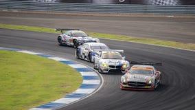 Quattro automobili il giorno SuperGT delle corse intorno a 7 2014 in Burirum, Tailandia Fotografie Stock Libere da Diritti