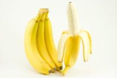 Quattro banane isolate su bianco Fotografia Stock