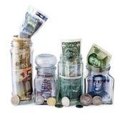 Quattro barattoli dei soldi Fotografie Stock Libere da Diritti