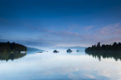 Quattro barche sul lago Immagini Stock