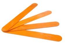 Quattro bastoni arancio del ghiacciolo per le arti ed i mestieri sopra Fotografia Stock Libera da Diritti