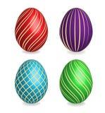 Quattro belle uova di Pasqua dipinte. fotografia stock