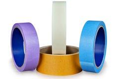 Quattro bobine del nastro di condotta su un fondo bianco Fotografia Stock