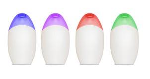 Quattro bottiglie in bianco delle estetiche Immagini Stock Libere da Diritti