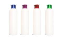 Quattro bottiglie in bianco delle estetiche Fotografia Stock