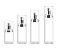 Quattro bottiglie cosmetiche trasparenti Fotografia Stock Libera da Diritti