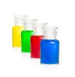 Quattro bottiglie del laboratorio con i liquidi variopinti Fotografia Stock