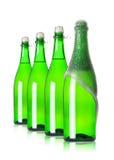 Quattro bottiglie di champagne nella riga Fotografia Stock Libera da Diritti