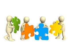 Quattro burattini, tenenti in mani un puzzle