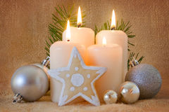 Quattro candele di avvenimento. Immagine Stock