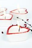 Quattro candele heart-shaped Immagine Stock Libera da Diritti