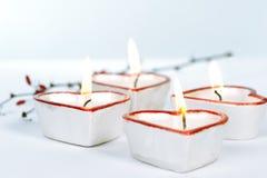 Quattro candele heart-shaped Fotografia Stock Libera da Diritti