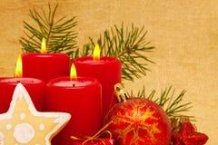 Quattro candele rosse di avvenimento. Fotografie Stock Libere da Diritti