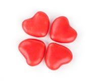 Quattro caramelle a forma di del cuore Immagini Stock Libere da Diritti