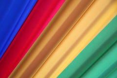 Quattro colori diagonali vibranti come fondo fotografia stock