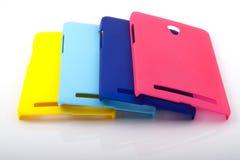 Quattro coperture posteriori dello smartphone luminoso Fotografie Stock