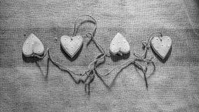 Quattro cuori collegati insieme alla corda Fotografia Stock