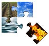 Quattro elementi in un puzzle - fuoco a parte Immagine Stock Libera da Diritti