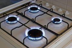 Quattro fiamme blu del gas Immagine Stock Libera da Diritti