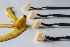 Quattro forcelle con la banana Fotografia Stock Libera da Diritti