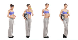 Quattro giovani donne in vestiti sportivi che tengono le mele immagine stock