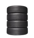 Quattro gomme di gomma nere dell'automobile su bianco Fotografia Stock