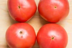 Quattro grandi pomodori Fotografie Stock Libere da Diritti