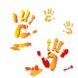 Quattro handprints multicolori su un fondo bianco Concetto per il festival delle pitture royalty illustrazione gratis