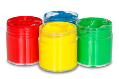 Quattro latte della vernice di colore Fotografie Stock