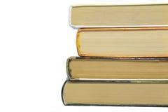 Quattro libri su a vicenda fotografia stock libera da diritti