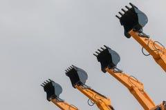 Quattro macchine d'acciaio di industriale dei secchi immagini stock