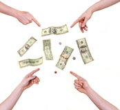 Quattro mani che indicano ai dollari Fotografia Stock Libera da Diritti