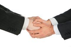 Quattro mani di handshaking Fotografia Stock Libera da Diritti